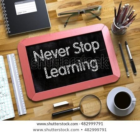 Small Chalkboard with Never Stop Learning. 3D. Stock photo © tashatuvango