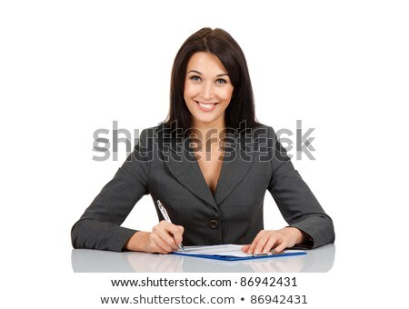 Woman sitting at table writing Stock photo © IS2