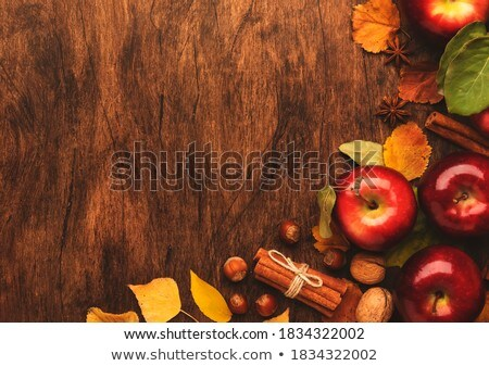 Ripe apple with fallen leaves and spices Stock photo © dash