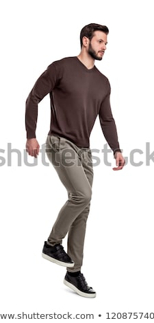 handsome casual man walking forward looks down to side Stock photo © feedough