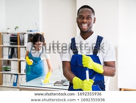 vrouw · schoonmaken · tabel · vod · huis · gelukkig - stockfoto © andreypopov