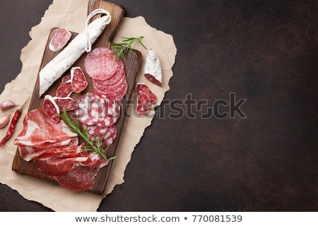 slices of bacon on slate cutting board stock photo © furmanphoto