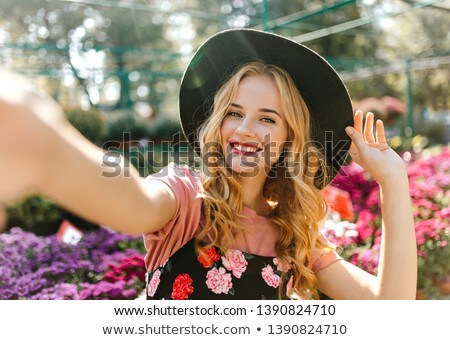 Stunning natural beauty with blonde wavy hair. Stock photo © studiolucky