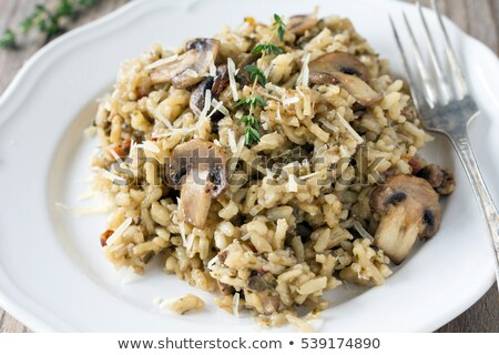 Delicioso cogumelos risotto queijo parmesão salsa vinho branco Foto stock © karandaev