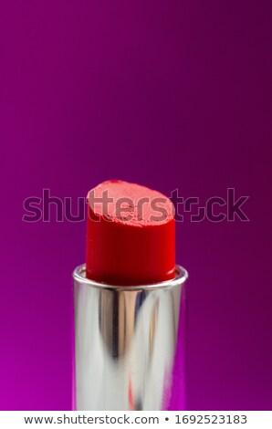 Close up view of beautiful woman lips with purple matte lipstick. Cosmetology, drugstore or fashion  Stock photo © serdechny