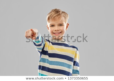 smiling boy in striped pullover pointing finger Stock photo © dolgachov