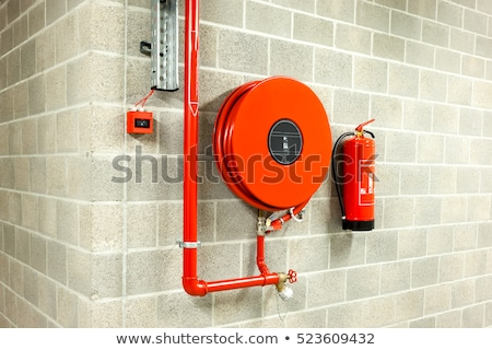 Fire Hose Reel And Fire Extinguisher Stock photo © AndreyPopov