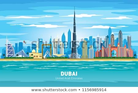 Dubai Skyline with Color Buildings, Blue Sky and Reflection. Stock photo © ShustrikS