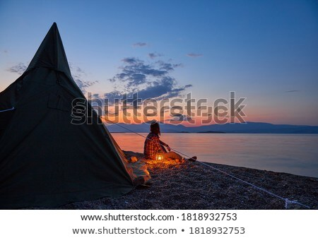 Man sitting in front of his tent Stock photo © photography33