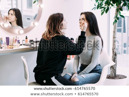 Young woman examining make-up Stock photo © stokkete