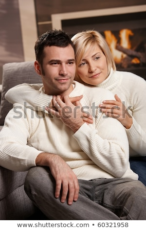 Couple In Winter Clothing Looking Away Stock photo © unkreatives
