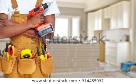 Bouwer klusjesman bouw tools Rood huis Stockfoto © Kurhan
