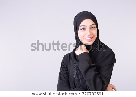 Smiling young lady with a white backgound. stock photo © stockfrank