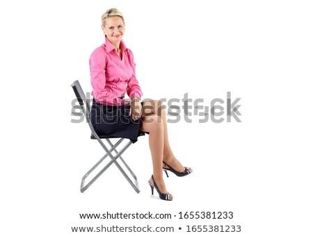 black businesswoman seated on chair stock photo © szefei