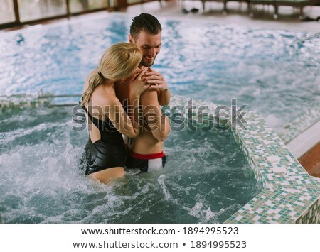 Young couple standing at poolside Stock photo © IS2