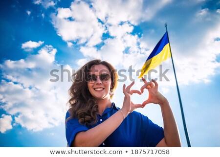 Young cheerful woman Stock photo © acidgrey