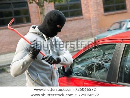 Masked Man Breaking Into Car With Crowbar Stock photo © HighwayStarz