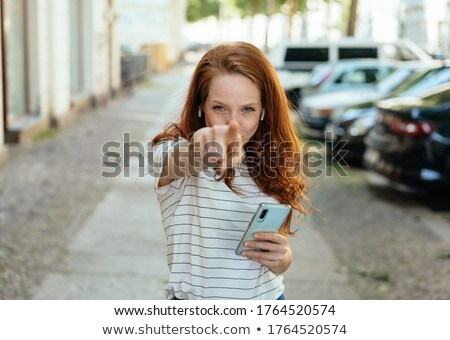 Intense woman pointing to her mobile phone Stock photo © Giulio_Fornasar
