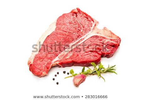 T-bone beef steak cooking on grill Stock photo © karandaev