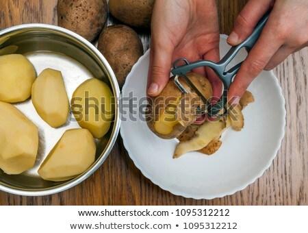 Potatoes with Peeler and Peeled Skin Stock photo © juniart