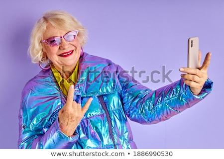 Blond fashion woman in red talking smartphone Stock photo © lunamarina