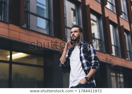 homem · falante · telefone · móvel · rua · feliz · moço - foto stock © deandrobot