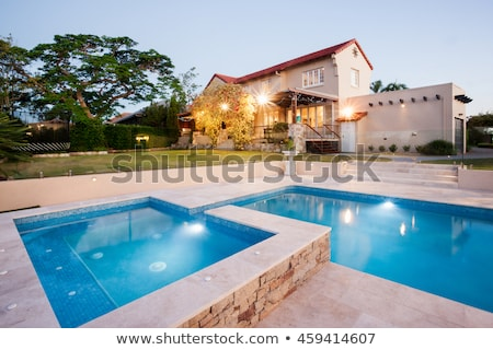 blue tiles swimming pool with green grass garden stock photo © lunamarina