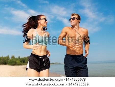Aire libre playa escuchar música Foto stock © deandrobot