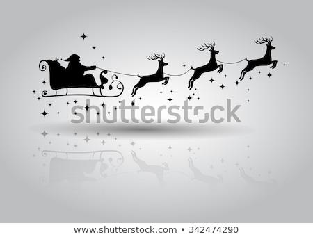 Silhouette deer and santa in winter night Stock photo © colematt