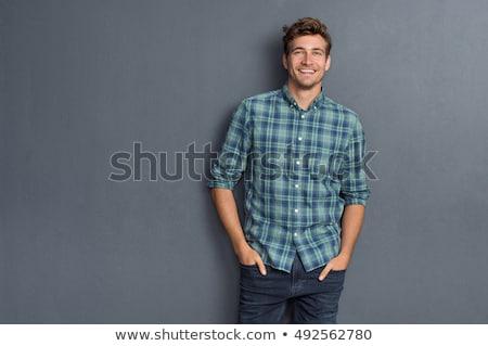 Jóképű fiatalember mosolyog fekete stúdiófelvétel arc Stock fotó © ajn