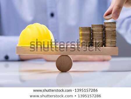 Stack Coins And Yellow Hard Hat On Desk Stock photo © AndreyPopov