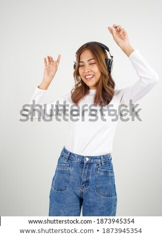 Stock photo: Swaying to the music with headphones on