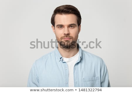 Attractive male freelancer with confident serious expression, works distantly, dressed in elegant wh Stock photo © vkstudio