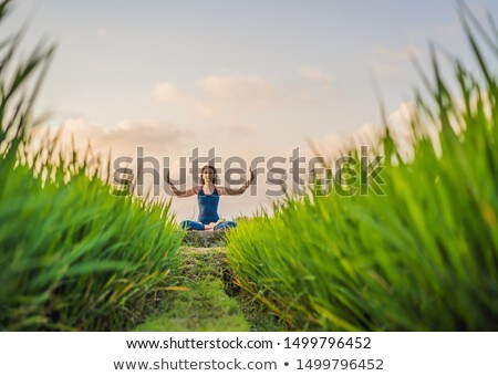 Young woman practice yoga outdoor in rice fields in the morning during wellness retreat in Bali BANN Stock photo © galitskaya