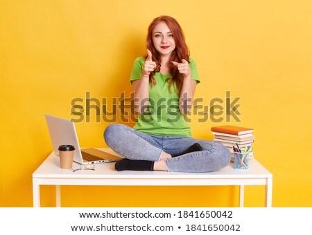Obraz nice zachwycony kobieta patrząc kamery Zdjęcia stock © deandrobot