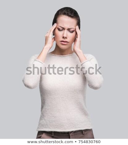 woman having a headache isolated on white stock photo © dacasdo