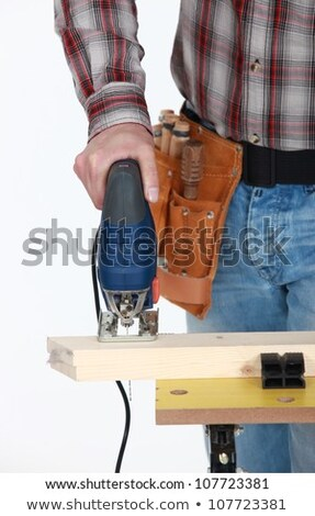 A cropped picture of a handyman using a jigsaw. Stock photo © photography33