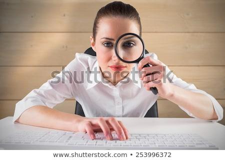 Komoly üzletasszony néz nagyító fiatal iroda Stock fotó © wavebreak_media