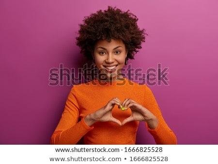 belle · jeune · femme · permanent · forme · de · coeur · mains - photo stock © stockyimages