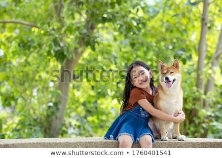 girls and puppy in the garden stock photo © witthaya