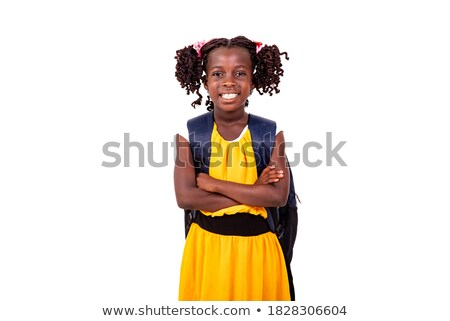 smiling girl with arms crossed wearing backpack stock photo © stryjek