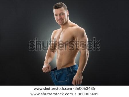 Muscular homem solto jeans sem camisa Foto stock © wavebreak_media