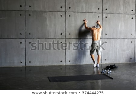 Foto stock: Fitness man Torso with towel in a gym