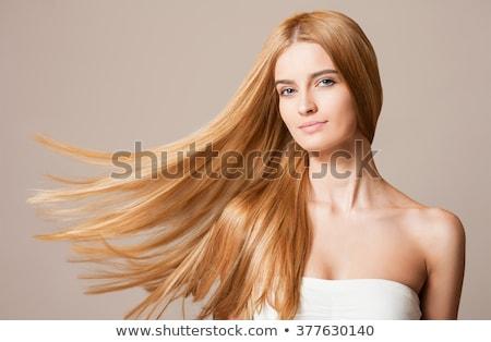 Dinamikus fotó csinos szőke nő Stock fotó © lithian
