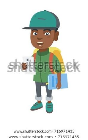 Afrikaanse schooljongen mobieltje leerboek glimlachend Stockfoto © RAStudio