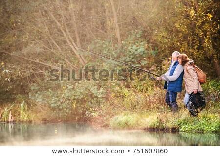 ходьбе воды пляж женщину человека Сток-фото © wavebreak_media