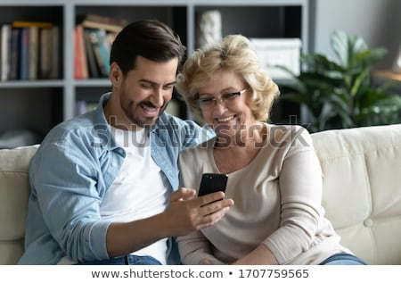 Senior Adult man and younger man Stock photo © IS2