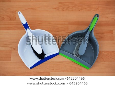 Overhead view of brushs with dustpans on hardwood floor Stock photo © wavebreak_media