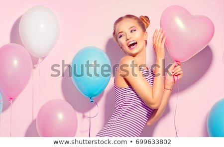portrait of a cheerful young girl in dress stock photo © deandrobot