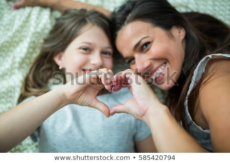 Mother And Daughter Making Heart Shape Stock photo © AndreyPopov